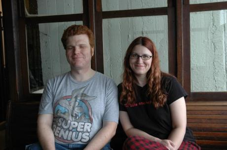 "One of my favorite pictures of me and my husband, even though his eyes are closed.  His shirt says ""Super Genius"" and mine says ""All this and nerdy too"" - it's like we were made for each other or something. :)"